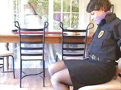 Policewoman ziptied to stool  to scissors