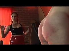 Dominatrix spanking, and using whip on her slave