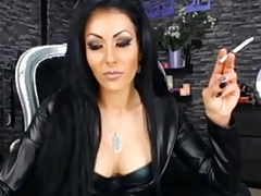 Smoking Dominatrix in leather