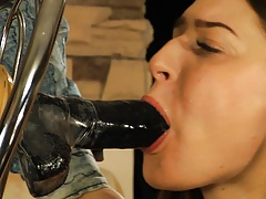 Pretty damsel inhales dildo, and gets rubber band punishment.