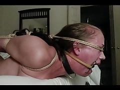 Hogtied girl face poked