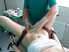 Girl's climax on the gynecological tabouret