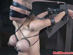 Tied marionette caned after water