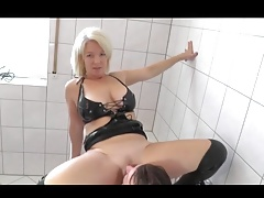 Scorching misstress urinates on her victim