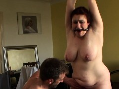 Chubby brit slave ball-gagged and doggystyled