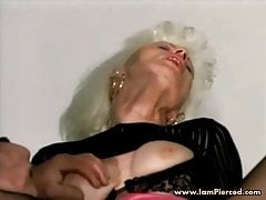 Iam Pierced granny with vulva piercings pummeling in the car
