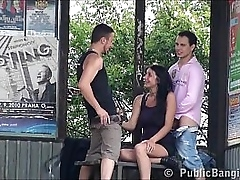 A cute dominate woman is fucked apart from 2 guys in public line bang orgy