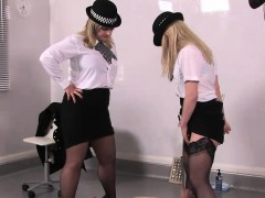 Uniform mistresses pissing on dastard slave