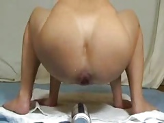 Fledgling hoe fisting her donk with massive bottle.