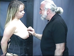 Busty brunet honey in corset gets mouth drilled and gags on hard-on
