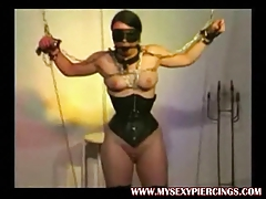 Powerful pierced marionette with weights on her pierced poon