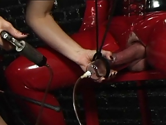 Red and  spandex mistress Bondage & discipline  play in this sex dungeon space