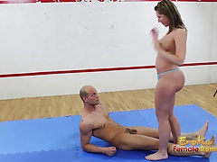 Dark haired on mat controls her submissive fellow