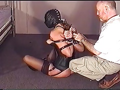 trussed corseted woman in leather