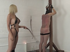 Horny light-haired dominatrix whips and tortures her sub