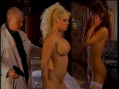 Naughty doc in smacking action with 2 big hooter bombshells