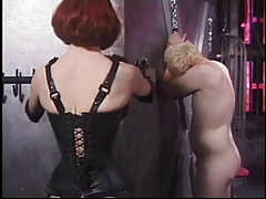 Ginger dominatrix lashing her blonde masculine