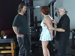 Molten redhead is confined with red straps and has her rump spanked hard