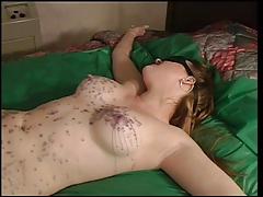 Julie Simone in nylons enjoying steamy paraffin wax over her figure