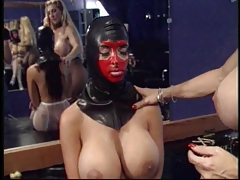 Domme  slave's beaver and puts anal invasion beads