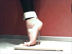 Torment to stand on Tiptoes with Nails and Trussed