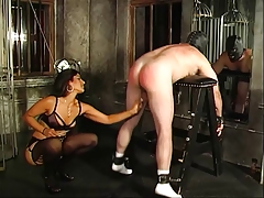 Sizzling looking dominatrix Delilah spanks her bent-over  backside