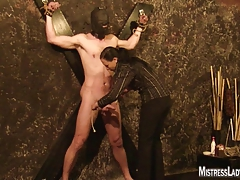 Lady Jenny torments victim  to the wall