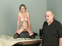 Short-haired b-cup blond lowers her pussy onto mechanical