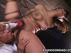 Insatiable Japanese babe in bondage receives a mischievous